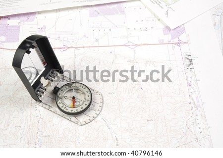 Topographical maps of an area under development with a compass - stock photo