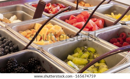 Toppings for frozen yogurt. - stock photo