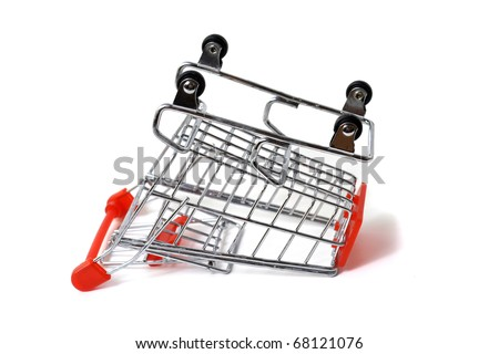 toppled over shopping cart isolated on white - stock photo