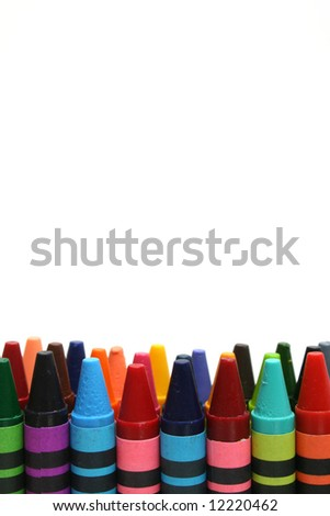 tops of crayons in front of white background - stock photo