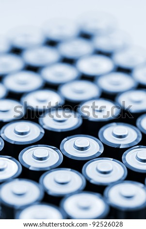 Tops of many AA batteries in closeup - stock photo