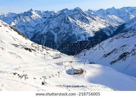 Tops of winter alp mountains at sunny day - stock photo
