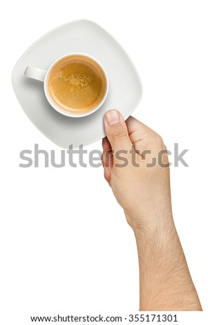 Topview of hand holding and serving white cup of coffee with saucer isolated - stock photo