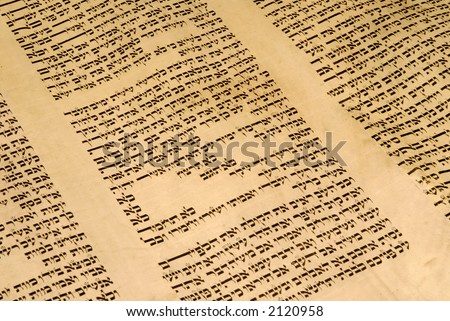 Torah scroll (Opened to Exodus Chapter 20, the Ten Commandments) - stock photo