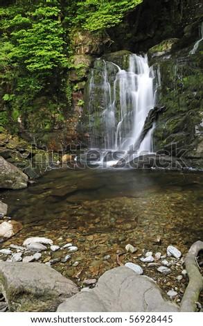 Torc waterfall in Irish National Park - stock photo