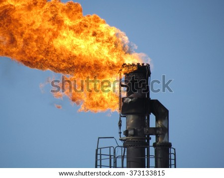 Torch system on an oil field - stock photo