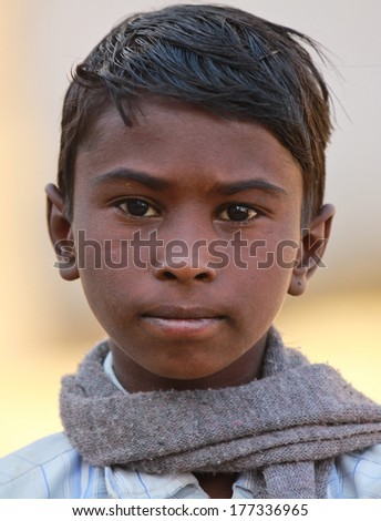 TORDI GARH, INDIA � MARCH 1: An unidentified child inside the village of Tordi Garh, Rajasthan, Northern India on March 1, 2012. The fort and palace are occupied by BH. Hemendra Singh and his family. - stock photo