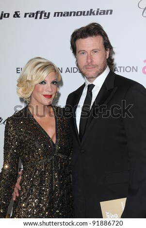 Tori Spelling and Dean McDermott at the 19th Annual Elton John Aids Foundation Academy Awards Viewing Party, Pacific Design Center, West Hollywood, CA. 02-27-11 - stock photo