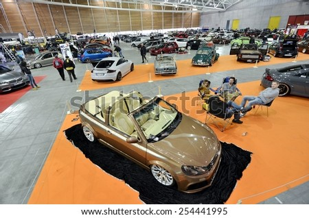 TORINO, ITALY - FEBRUARY 15, 2015: A Exposition of different tuned cars on display at Expo Tuning Torino. Special edition of Volkswagen Golf cabriolet in Torino business place on February 15, 2015 - stock photo
