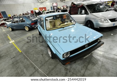TORINO, ITALY - FEBRUARY 15, 2015: A Exposition of different tuned cars on display at Expo Tuning Torino. Special edition of vintage Volkswagen Golf in Torino business place on February 15, 2015 - stock photo