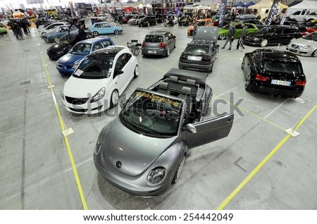 TORINO, ITALY - FEBRUARY 15, 2015: A Exposition of different tuned cars on display at Expo Tuning Torino. Special edition of Volkswagen New Beetle in Torino business place on February 15, 2015 - stock photo