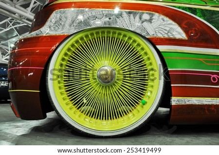 TORINO, ITALY -  FEBRUARY 15, 2015: close up of very big and special colored sportive car rim ray exposed at Expo Tuning Torino business place on February 15, 2015 - stock photo