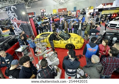 TORINO, ITALY - FEBRUARY 15, 2015: View of the public watching the cars on display at Expo Tuning Torino. Special edition Ferrari 360 Modena spider in Torino business place on February 15, 2015 - stock photo