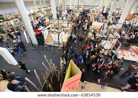 TORINO, ITALY - OCT. 24: Panoramic view of people visiting stands at Salone del Gusto, international fair of tastes and slow food on October 24, 2010 in Torino, Italy.