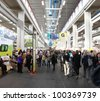 TORINO, ITALY - OCT. 24: People visit local and international food stands at Salone del Gusto, international fair of tastes and slow food on October 24, 2010 in Torino, Italy. - stock photo