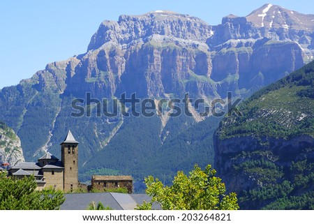 TORLA, SPAIN - JUNE 14, 2014: San Salvador Church. Torla is a gateway to the Ordesa y Monte Perdido National Park in the valley of Ordesa, and to Valle de Broto.
