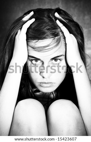 Tormented woman portrait in black and white. - stock photo