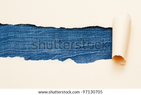 Torn beige paper with space for text with jeans texture background - stock photo