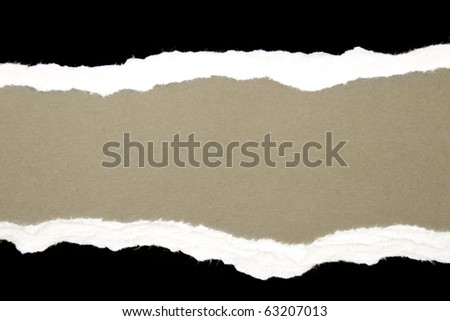 Torn black and white paper on brown background. Copy space - stock photo