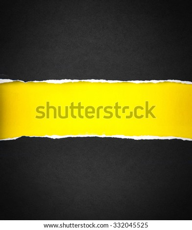 Torn black Paper and space for text with a  yellow paper background - stock photo