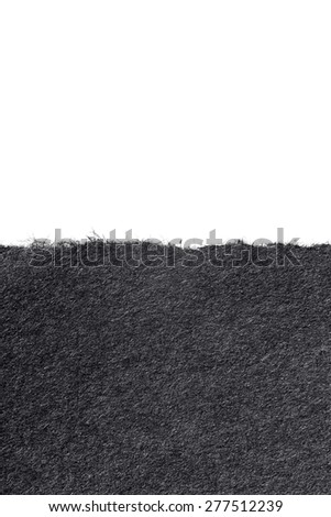 torn black paper or paperboard on a white background - stock photo