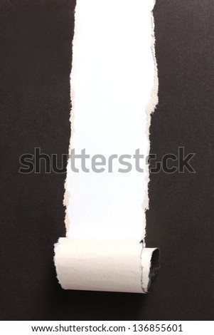 Torn black paper  with color background - stock photo