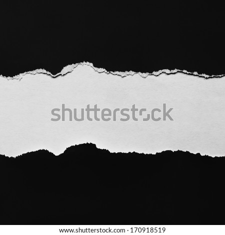 Torn black paper with space for copy. - stock photo