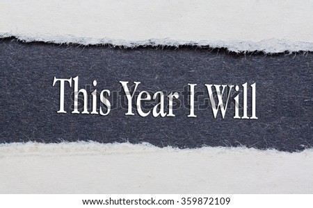 Torn Blue Paper and white background with this year i will written on. - stock photo
