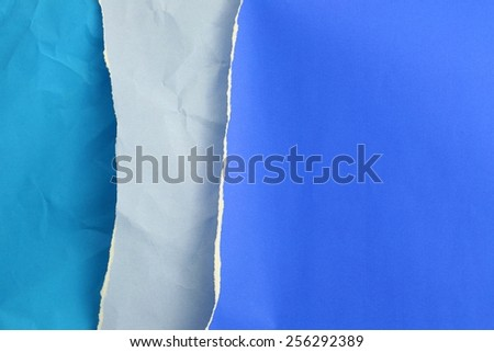 Torn blue paper for background