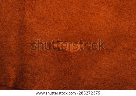 Torn Brown, Orange Leather for Concept and Idea Style of Fine Leather Crafting, Handcrafts, Handmade, handcrafted, leather worker. Background Textured and Wallpaper. Rustic Style. - stock photo