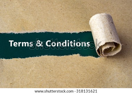 "Torn brown paper on green surface with ""Terms & Conditions"" words. - stock photo"