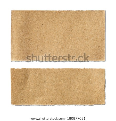 Torn brown paper sheet on white background - stock photo
