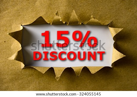 Torn brown paper with 15% DISCOUNT words - stock photo