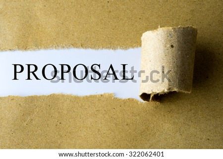 Torn brown paper with PROPOSAL word. - stock photo