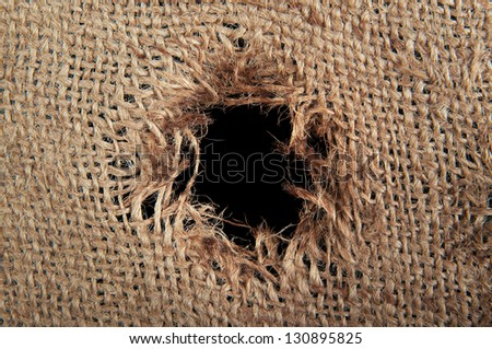 Torn burlap decayed. Ragged linen fabric. - stock photo