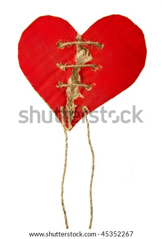 Torn cardboard heart symbol with rope isolated on white background - stock photo