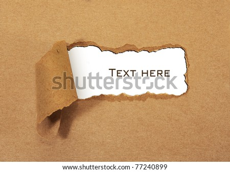Torn cardboard in the middle - stock photo