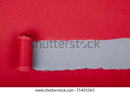Torn color wrapped paper with space for your message - stock photo