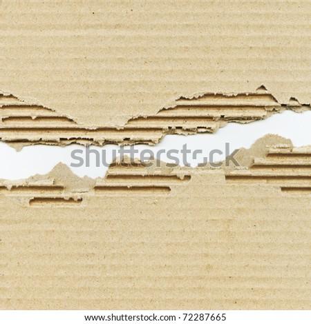 Torn corrugated cardboard - stock photo