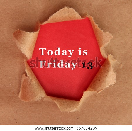 Torn craft paper with red background and text Today is Friday 13 - stock photo