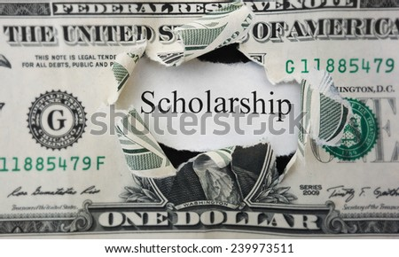 Torn dollar hole with Scholarship paper note                                - stock photo