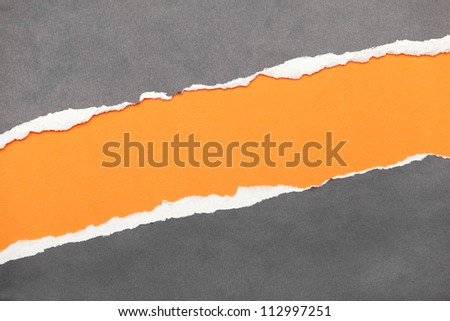 Torn edge paper with orange copyspace for your message - stock photo