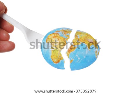 torn fragment of a map on a white background with an outstretched hand to it with a fork