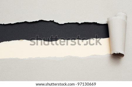 Torn gray paper with space for text with two band black and beige background - stock photo