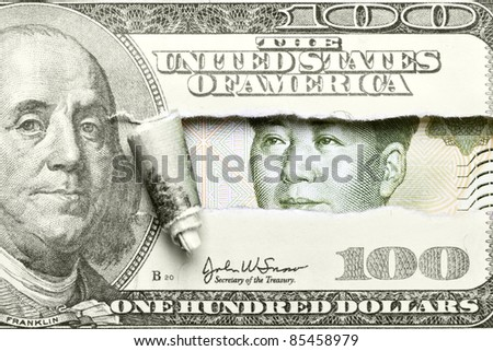 Torn hundred dollar bill with Mao from yuan - stock photo