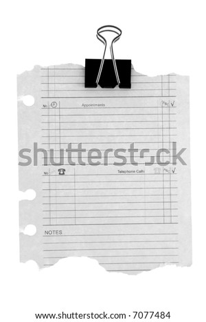 torn out diary page with a paper clip isolated on white - stock photo