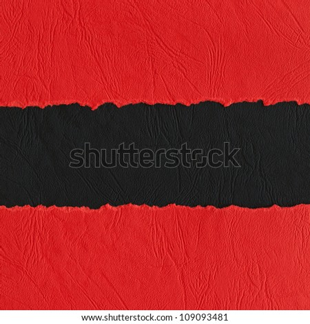 Torn paper background made of red and black strips. - stock photo