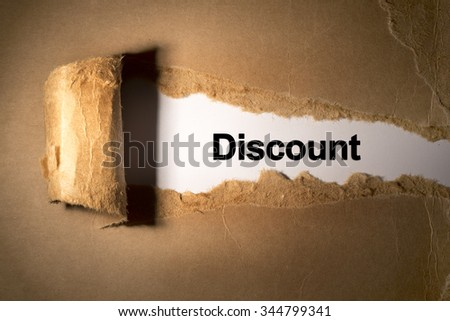 Torn paper box with word discount in low light - stock photo