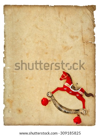 Torn paper. Christmas decoration vintage style rocking horse toy with aged paper page isolated on white background. Paper background - stock photo