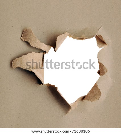 Torn paper - gray cardboard ripped apart showing underlying layer - stock photo